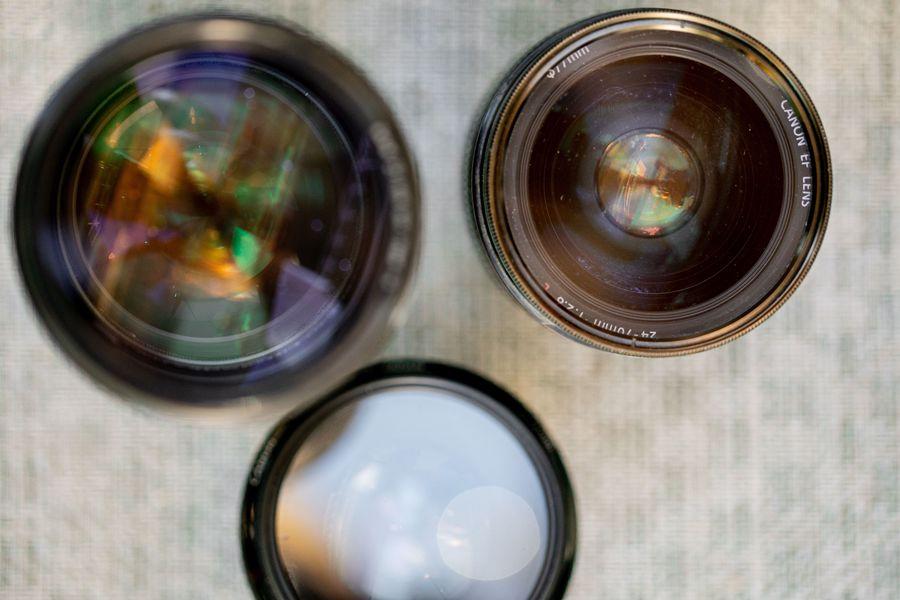 Close up of three Canon camera lenses