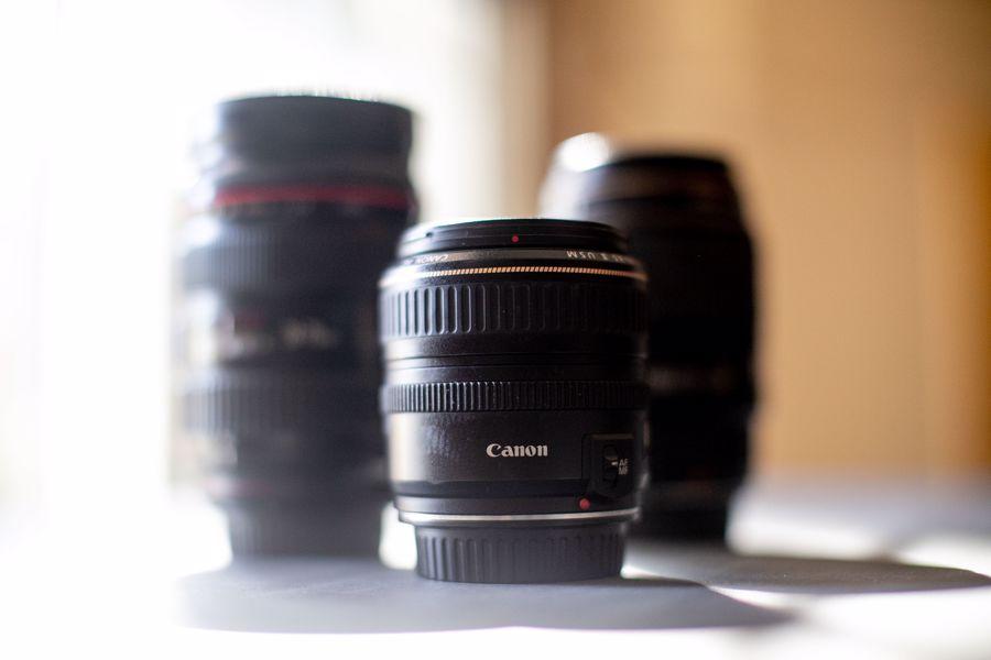 Three Canon camera lenses