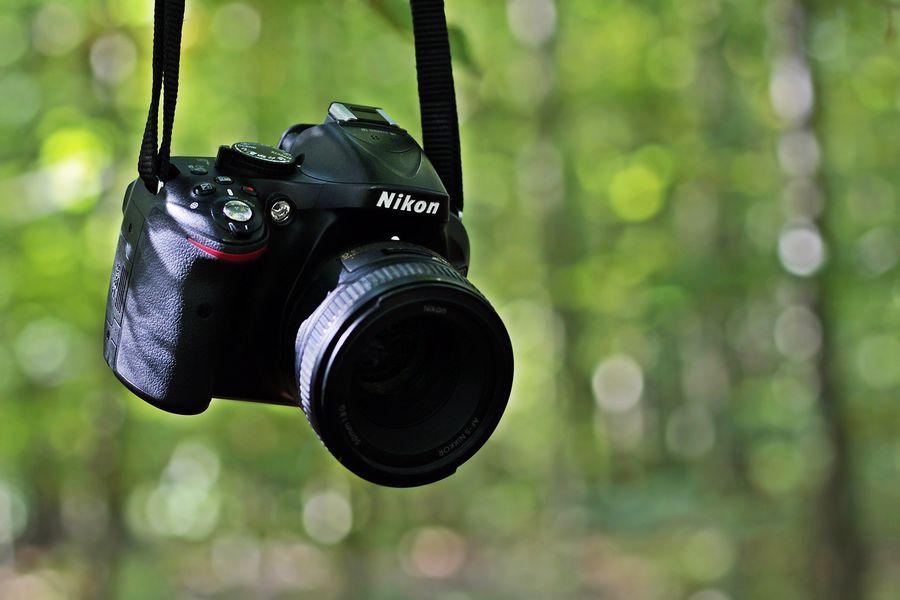 Nikon camera hanging on a tree