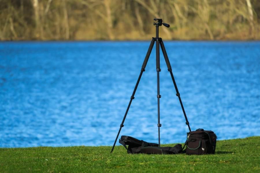 Tripod equipment placed near a lake