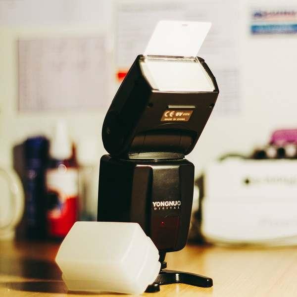 Yongnuo camera flash beside a diffuser