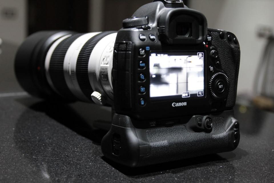 Canon camera on granite countertop