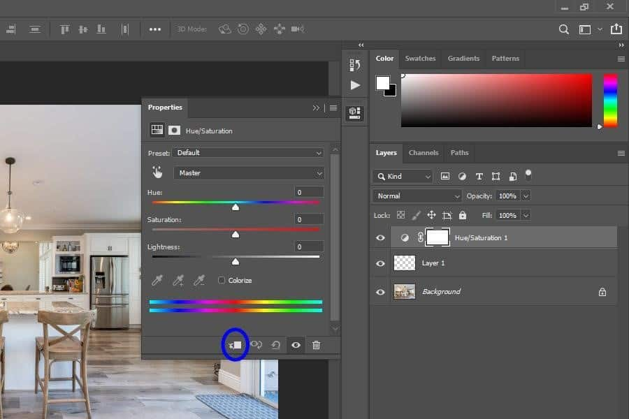 Selecting the 'Clipping Mask' button at the bottom of the properties box of the hue/saturation layer