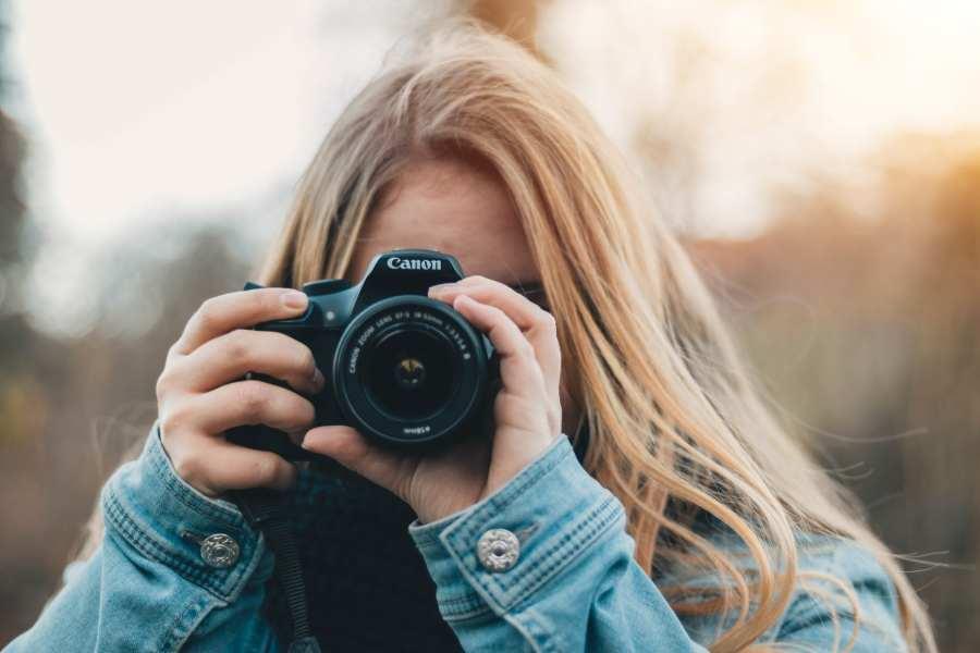 Woman taking photos during daytime