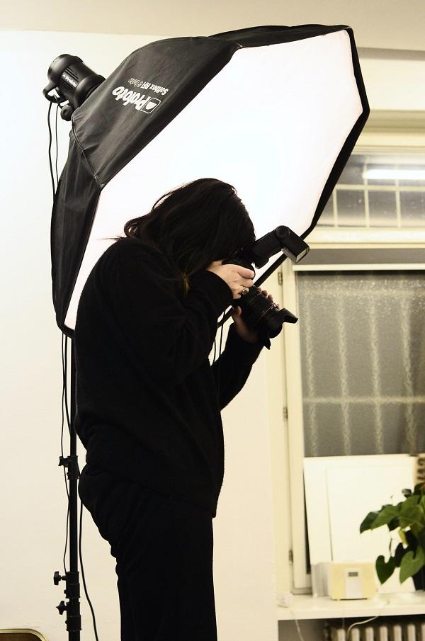 Photographer shooting with softbox lighting