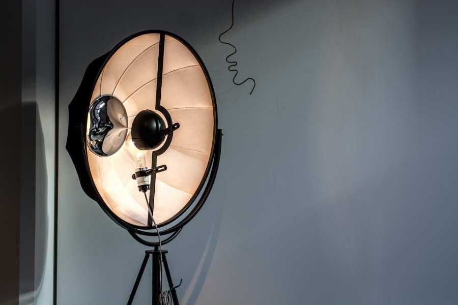 A reflective umbrella in a dark room