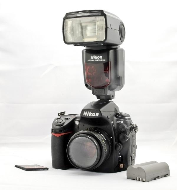 A Nikon camera with external flash