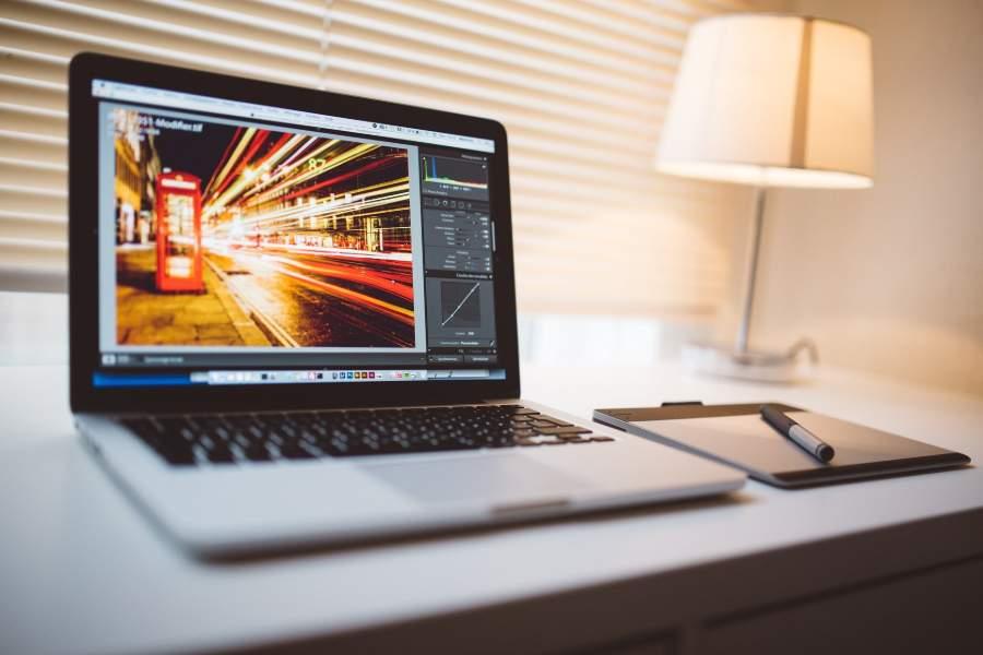 A tablet beside a laptop with Adobe Lightroom program