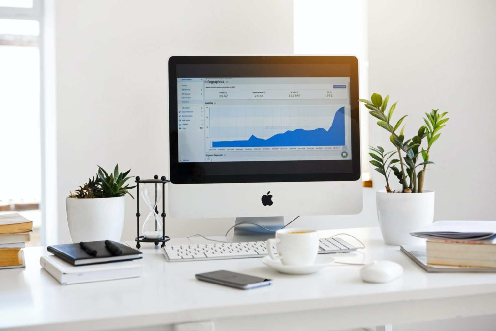 Computer screen on desk displaying a graph