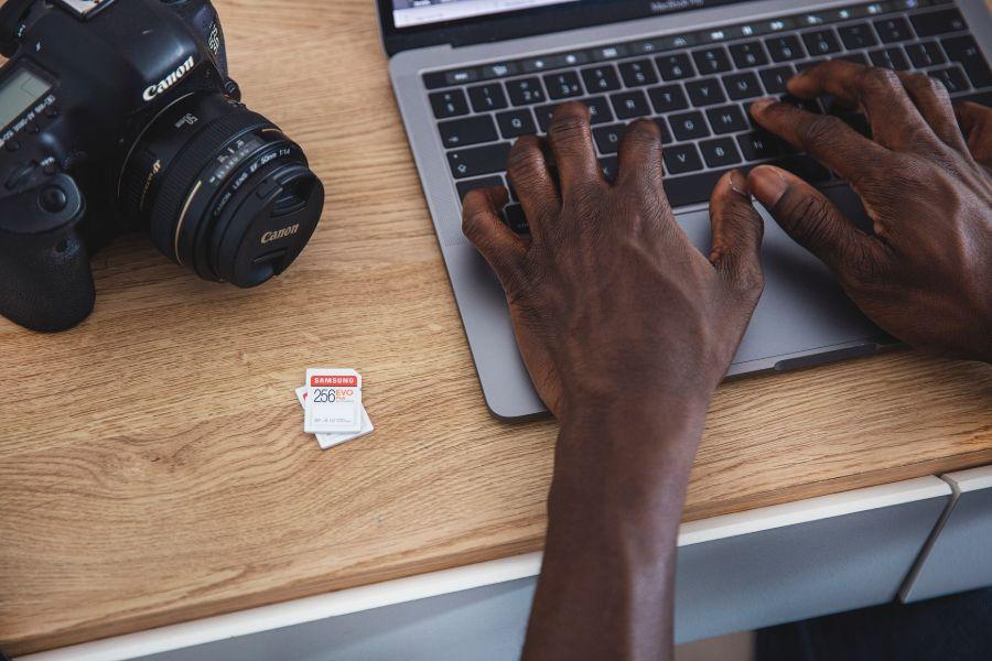 Man saving his real estate photos on a laptop
