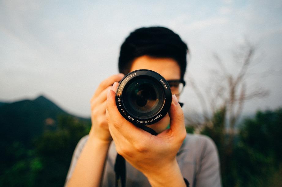 Focus shot of man using a camera